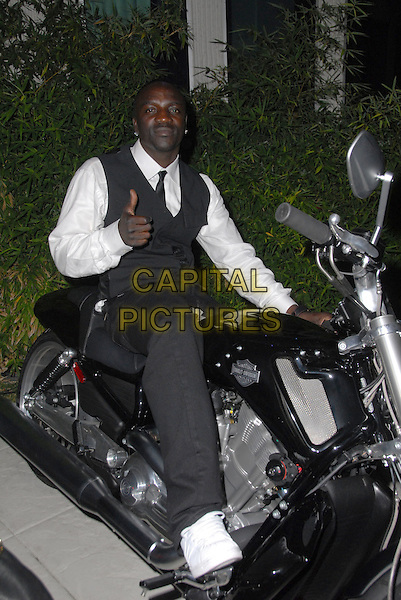 AKON.House Of Hype VMA Post-Party, held at a Private house, Hollywood, California, USA..September 7th, 2008.full length grey gray black sitting trousers waistcoat bike motorcycle motorbike.CAP/ADM/FS.©Faye Sadou/AdMedia/Capital Pictures.