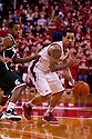 31 December 2011: Bo Spencer #23 of the Nebraska Cornhuskers dribbles the ball while guarded by Keith Appling #11 of the Michigan State Spartans during the second half at the Devaney Sports Center in Lincoln, Nebraska. Michigan State defeated Nebraska 68 to 55.
