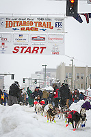 Curt Perano leaves the 2011 Iditarod ceremonial start line in downtown Anchorage, during the 2012 Iditarod..Jim R. Kohl/Iditarodphotos.com