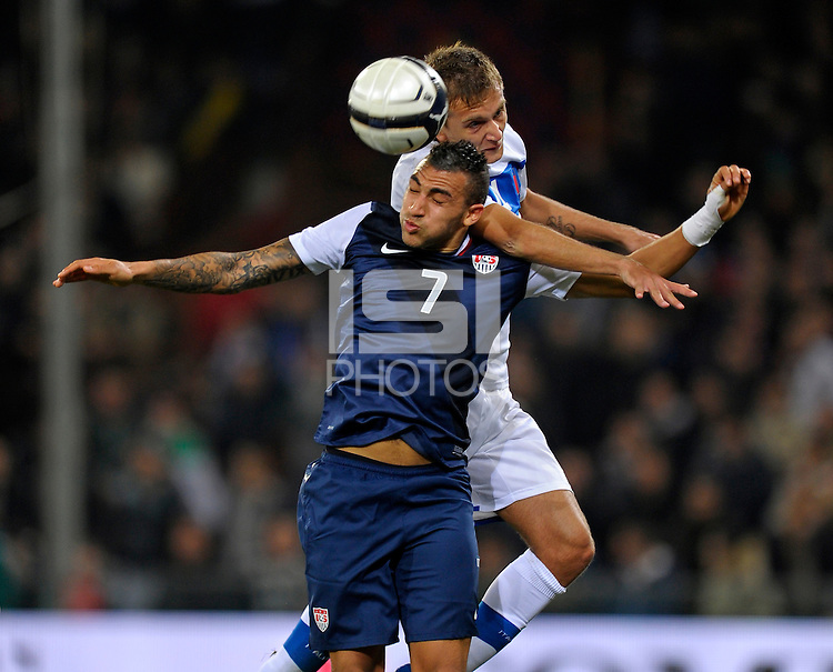 Danny Williams  (l, USA) vs. Domenico Criscito (ITA), during the friendly match Italy against USA at the Stadium Luigi Ferraris at Genoa Italy on february the 29th, 2012.