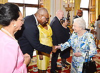 10 June 2016 - London, England - Queen Elizabeth II shakes hands with Sir Rodney Williams of Antigua and Barbuda, during a reception ahead of the Governor General's lunch at Buckingham Palace in London. Photo Credit: ALPR/AdMedia