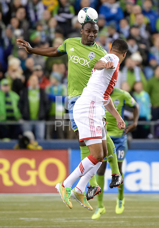 November, 2013: CenturyLink Field, Seattle, Washington: Seattle Sounders FC defender Jhon Kennedy Hurtado (34) heads the ball as the Portland Timbers take on the Seattle Sounders FC in the Major League Soccer Playoffs semifinals Round. Portland led 1-0 at the half.