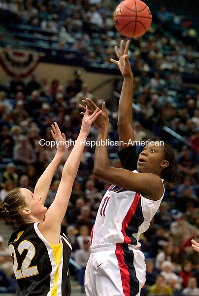 HARTFORD, CT. 18 March 2007-031807SV06--#31 Tina charles of UConn goes up for a shot as #22 Amanda Robinson of UMBC defends during the first round of NCAA action at the Civic Center in Hartford Sunday.<br /> Steven Valenti Republican-American