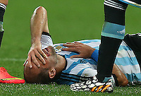 Pablo Zabaleta of Argentina suffers a deep cut to his right cheek