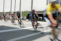 The Senior 3 division peddles past the Alliant Energy tower during the 2009 Iowa Criterium Championship held in downtown Cedar Rapids on Sunday, July 5, 2009. (Chris Mackler/The Gazette).