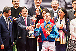 Jockey Joao Moreira, who rides Rapper Dragon, celebrates with the prize after winning 2017 BMW Hong Kong Derby Race at the Sha Tin Racecourse on 19 March 2017 in Hong Kong, China. Photo by Marcio Rodrigo Machado / Power Sport Images