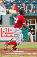 Maikel Franco (18) of the Lakewood BlueClaws follows through on his swing against the Greensboro Grasshoppers at NewBridge Bank Park on August 18, 2012 in Greensboro, North Carolina.  The Grasshoppers defeated the BlueClaws 9-4.  (Brian Westerholt/Four Seam Images)