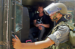 IDF soldiers arrest a peace activist after entering the village of An Nabi Salih near Ramallah on 11/06/2010. The activist was arrested shortly after one of his fellow activists was injured by the Israeli soldiers.