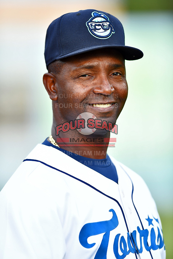 Asheville Tourists hitting coach Paco Martin (7) before a game against the Greensboro Grasshoppers at McCormick Field on May 10, 2018 in Asheville, North Carolina. The Tourists defeated the Grasshoppers 10-5. (Tony Farlow/Four Seam Images)