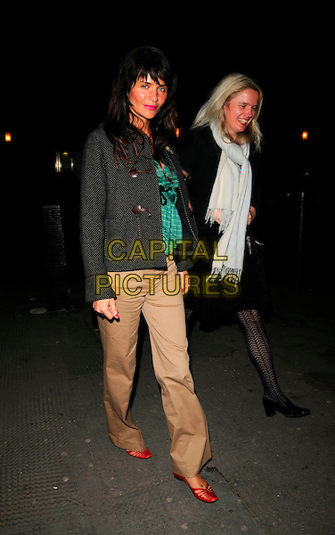 HELENA CHRISTENSEN & GUEST.Spotted at The Ivy restaurant, London, England..April 3rd, 2008.full length black grey gray jacket trousers brown beige green shirt top bag purse red pumps shoes coat white pashmina .CAP/CAN.©Can Nguyen/Capital Pictures.
