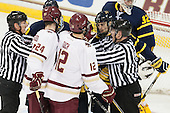 Chris Aughe and Bob Bernard separate the players. - The Boston College Eagles defeated the visiting Merrimack College Warriors 2-1 on Wednesday, January 21, 2015, at Kelley Rink in Conte Forum in Chestnut Hill, Massachusetts.