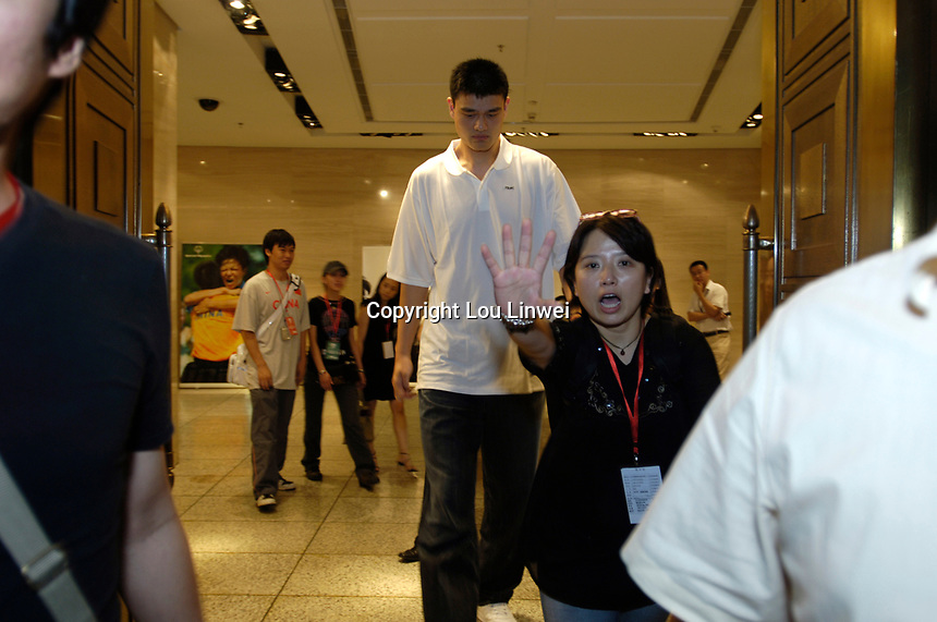 NBA Houston Rockets player Yao Ming attends a press conference for the 2007 Special Olympics in Beijing, China.  July 21, 2006. (photo by Lou Linwei/Sinopix)