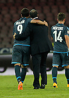 Gonzalo Higuain  and  Rafael Benitez   celebrate at the end ofthe Italian Serie A soccer match between SSC Napoli and Verona  at San Paolo stadium in Naples, October 26, 2014