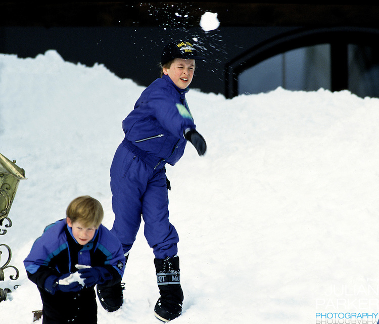 Prince William, and Prince Harry, throw snowballs in Lech, Austria, while on holiday with their mother, The Princess of Wales