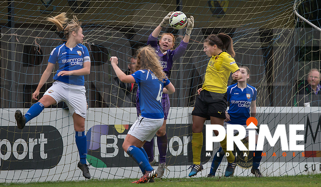 Goalkeeper Sophie Harris of London Bees gathers the ball under pressure from Ellie Mason of Watford Ladies during the final FAWSL2 match of the 2015 season between Watford Ladies and London Bees at Berkhamsted FC, Berkhamstead, England on 18 October 2015. Photo by Andy Rowland.