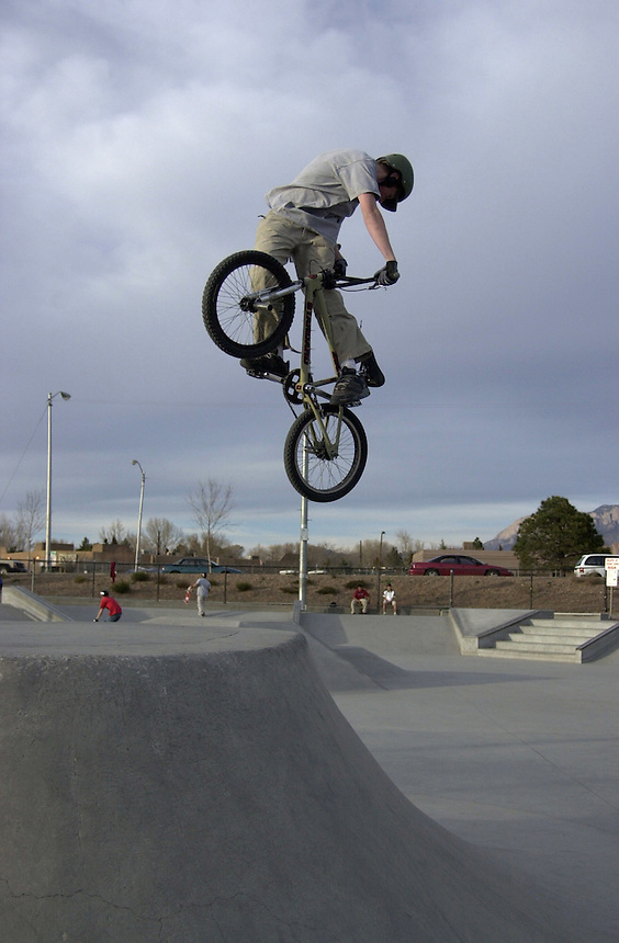 A BMX rider pulls a turndown over the volcano obstacle at Los Altos skatepark in Albuquerque, NM in 2002.