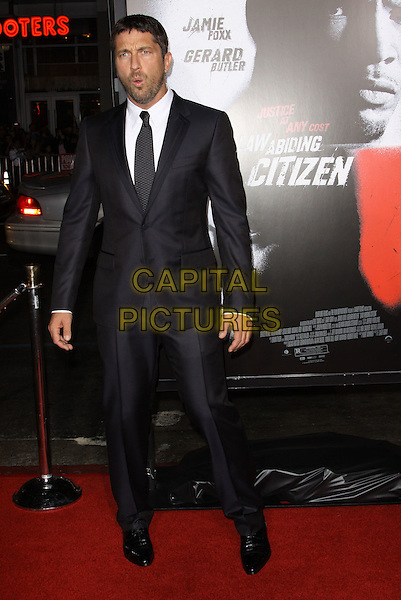GERARD BUTLER.The Overature Film L.A. Premiere of Law Abiding Citizen held at The Grauman's Chinese Theater in Hollywood, California, USA. .October 6th, 2009 .full length grey gray suit black mouth open funny face .CAP/ADM/KB.©Kevan Brooks/AdMedia/Capital Pictures.