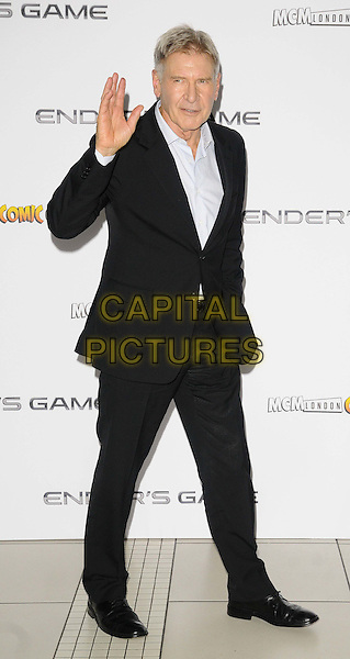 Harrison Ford<br /> The &quot;Ender's Game&quot; fan event &amp; photocall, Odeon Leicester Square cinema, Leicester Square, London, England.<br /> October 7th, 2013<br /> full length black white shirt suit hand arm waving <br /> CAP/CAN<br /> &copy;Can Nguyen/Capital Pictures
