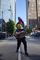 Tuba player practicing before the Seattle Pride Parade, Seattle PrideFest 2016, Washington, USA.