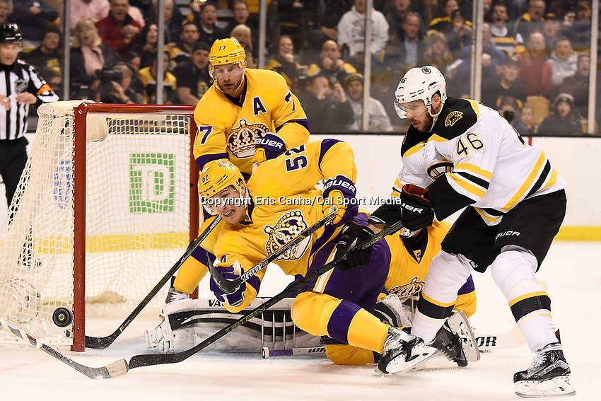 Tuesday, February 9, 2016: Los Angeles Kings defenseman Luke Schenn (52) and center Jeff Carter (77) work to cover the net as Boston Bruins center David Krejci (46) looks for the rebound during the National Hockey League game between the Los Angeles Kings and the Boston Bruins, held at TD Garden, in Boston, Massachusetts. The Kings defeat the Bruins 9-2. Eric Canha/CSM