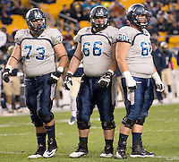 Old Dominion offensive linemen Jack Lowney (73), Troy Butler (66) and Josh Mann (60). The Pitt Panthers defeated the Old Dominion Monarchs 35-24 at Heinz Field, Pittsburgh, Pennsylvania on October 19, 2013.