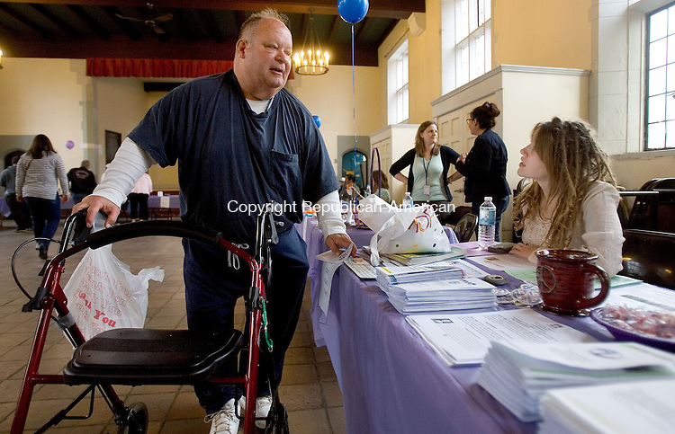 WATERBURY CT. 17 April 2015-041715SV01-Wayne Johnson of Waterbury talks with Hilary Bryant of TOIVO, a wellness center, at an All 4 One Day health fair at St. John's Episcopal Church in Waterbury Friday.<br /> Steven Valenti Republican-American