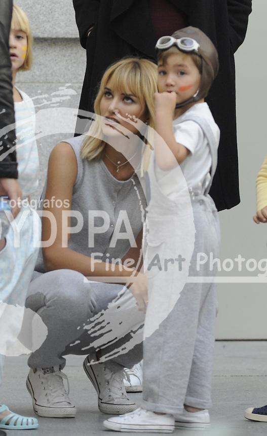 Fashion designer and model Alba Carrillo before show with her son ( Former moto Gp rider Fonsi Nieto´s son)