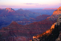 The setting sun casts a warm glow across the Grand Canyon near Yaki Point.