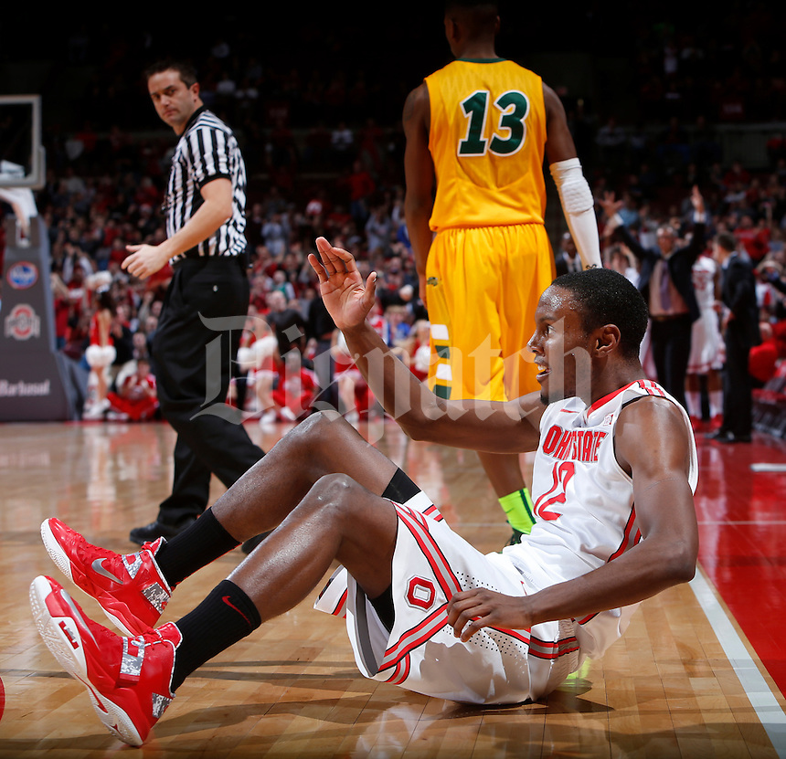 Ohio State Buckeyes forward Sam Thompson (12) looks for a hand up after being knocked to the floor during the first half of Saturday's NCAA Division I basketball game against the North Dakota State Bison at Value City Arena in Columbus on December 14, 2013.(Barbara J. Perenic/The Columbus Dispatch)