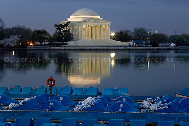 Jefferson Memorial with paddle boats on still tidal basin water before sunrise, Washington, DC