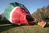 The balloon's nylon envelope inflates and begins to rise off the ground, British School of ballooning, Ebernoe, West Sussex.