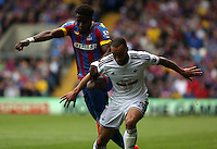 "Pictured L-R: Wilfried Zaha of Crystal Palace challenges Ashley ""Jazz"" Richards of Swansea<br />