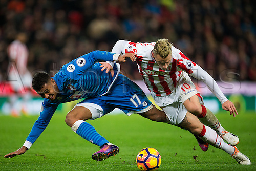 19.11.2016. Bet365 Stadium, Stoke, England. Premier League Football. Stoke City versus AFC Bournemouth. Bournemouth midfielder Joshua King and Stoke City forward Marko Arnautovic fight for a loose ball.