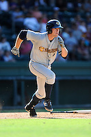 Left fielder Chris Breen (8) of the Charleston RiverDogs runs toward first base in a game against the Greenville Drive on Sunday, June 28, 2015, at Fluor Field at the West End in Greenville, South Carolina. Charleston won, 12-9. (Tom Priddy/Four Seam Images)