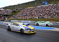 Jul. 20, 2014; Morrison, CO, USA; NHRA pro stock driver Allen Johnson (near lane) races alongside Dave Connolly during the Mile High Nationals at Bandimere Speedway. Mandatory Credit: Mark J. Rebilas-
