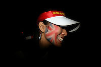 CHINA. Beijing. A spectator with a British Union Jack flag painted on her face during the Beijing 2008 Summer Olympics. 2008.