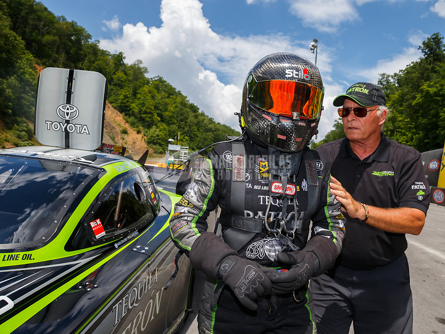 Jun 17, 2017; Bristol, TN, USA; NHRA funny car driver Alexis DeJoria during qualifying for the Thunder Valley Nationals at Bristol Dragway. Mandatory Credit: Mark J. Rebilas-USA TODAY Sports