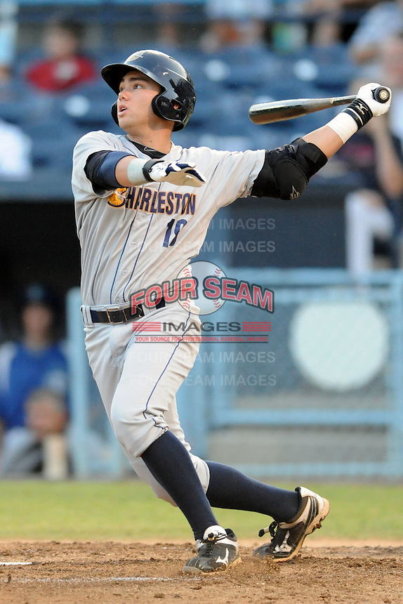 Charleston River Dogs third baseman Dante Bichette Jr. #19 swings at  a pitch during a game against the Asheville Tourists at McCormick Field on August 15, 2012 in Asheville, North Carolina. The Tourists defeated the River Dogs 6-0. (Tony Farlow/Four Seam Images).