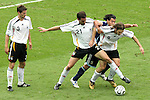 30 June 2006: Christoph Metzelder (GER) (21) and Torsten Frings (GER) (8) combine to bar access to the ball to the Argentine behind them. Germany tied Argentina 1-1 at the Olympiastadion in Berlin, Germany in match 57, a Quarterfinal game in the 2006 FIFA World Cup. Germany advanced on Penalty Kicks, 4-2.