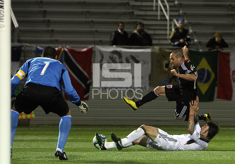 Branden Barklage(24) of D.C. United jumps over Danny Califf(4) of the Philadelphia Union during a play-in game for the US Open Cup tournament at Maryland Sportsplex, in Boyds, Maryland on April 6 2011. D.C. United won 3-2 after overtime penalty kicks.