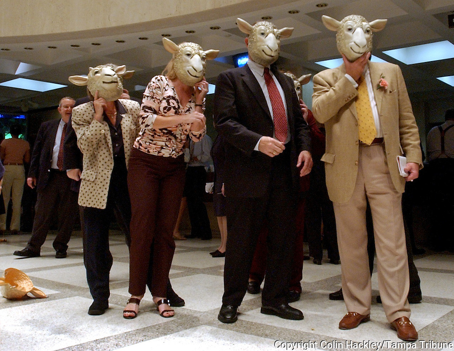 TALLAHASSEE, FL. 4/30/04-Poking fun at a comment by House Speaker Johnnie Byrd, R-Plant City, that House members are like sheep,  lobbyists wearing sheep masks wait for session to end Friday night at the Capitol in Tallahassee. COLIN HACKLEY PHOTO