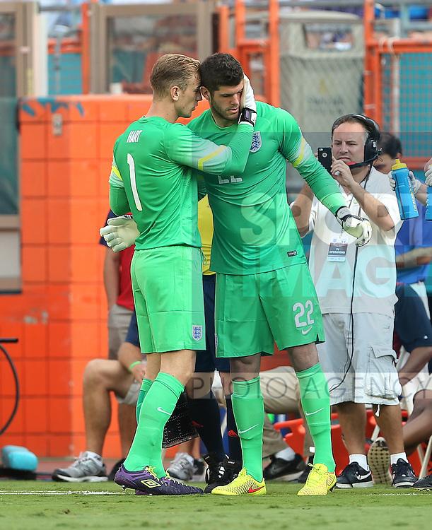 England's Joe Hart congratulates Fraser Forster as he comes on to make his debut<br /> <br /> England vs Honduras  - International Friendly - Sun Life Stadium - Miami - USA - 07/06/2014  - Pic David Klein/Sportimage