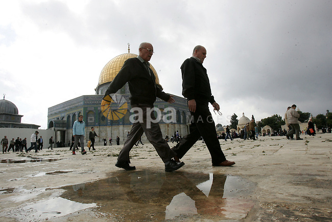 """Palestinians walk in front of the Dome of the Rock after Friday prayers at Al-Aqsa mosque compound in Jerusalem's old city on Nov. 4,2011, ahead of the Muslim Eid al-Adha festival at the end of the week. Muslims across the world are preparing to celebrate the annual """"Festival of Sacrifice"""", which marks the end of the Hajj pilgrimage to Mecca and in commemoration of Prophet Abraham's readiness to sacrifice his son to show obedience to God. Photo by Mahfouz Abu Turk"""