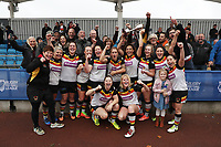 Picture by Paul Currie/SWpix.com - 07/10/2017 - Rugby League - Women's Super League Grand Final - Bradford Bulls v Featherstone Rovers - Regional Arena, Manchester, England - Bradford celebrate at the final whistle with the the trophy and fans