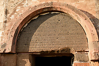 Armenian script over thr door of the cathedral of Ani, Also known as Surp Asdvadzadzin (church of the Holy Mother of God), its construction was started in the year 989, under King Smbat II.  Ani archaelogical site on the Ancient Silk Road , Anatolia, Turkey
