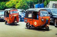 Java, Jakarta. Two Bajaj in Kemang Raya, Jakarta Indonesia. Traffic in Jakarta is often dense, polluted and noisy.
