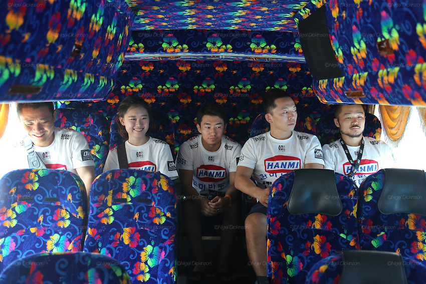 Dae Hwan Kim, Kamma Bantam weight champion, and his team in the coach on their way to the Stadium<br /><br />MMA. Mixed Martial Arts &quot;Tigers of Asia&quot; cage fighting competition. Top professional male and female fighters from across Asia, Russia, Australia, Malaysia, Japan and the Philippines come together to fight. This tournament takes place in front of a ten thousand strong crowd of supporters in Pelaing Stadium. Kuala Lumpur, Malaysia. October 2015