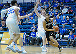 January 24, 2017:  San Diego State guard, Trey Kell #3, drives past Falcon center, Frank Toohey #33, during the NCAA basketball game between the San Diego State Aztecs and the Air Force Academy Falcons, Clune Arena, U.S. Air Force Academy, Colorado Springs, Colorado.  Air Force defeats San Diego State 60-57.