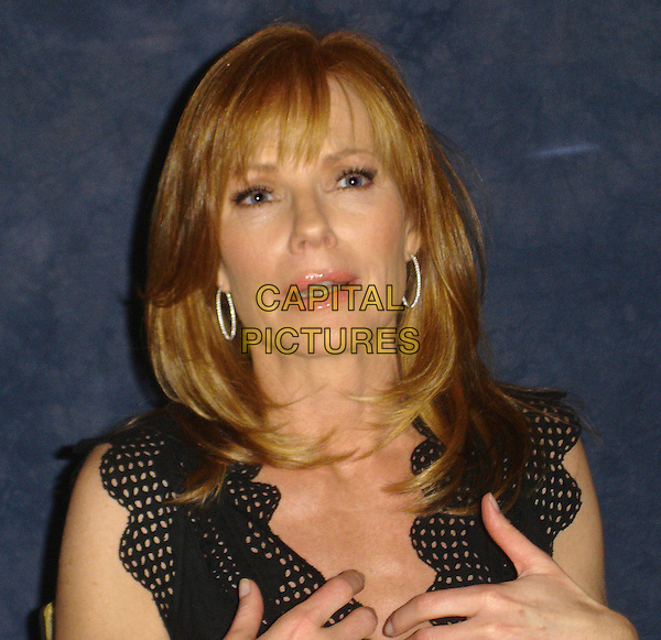 """MARG HELGENBERGER .Press conference for """"Mr. Brooks"""", Le Meridian, Beverly Hills, California, USA..May 21st, 2007.headshot portrait hoop earrings .CAP/AW.©Anita Weber/Capital Pictures"""