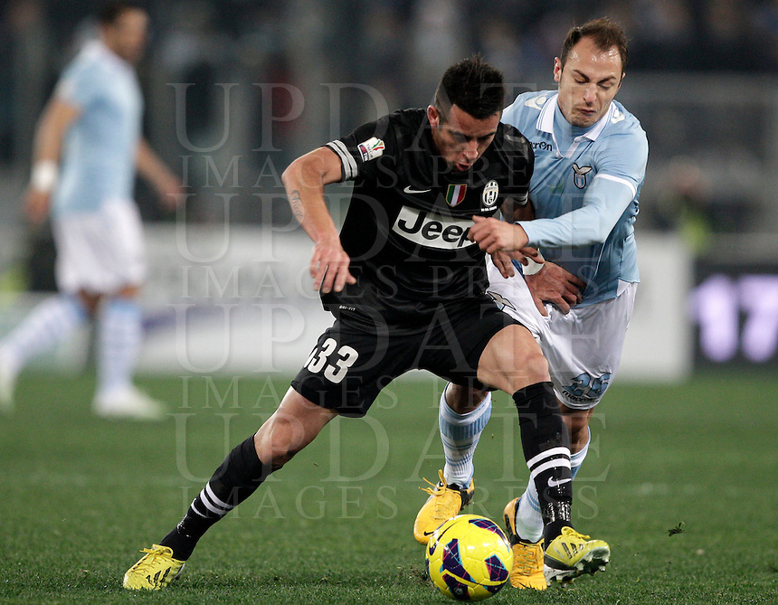 Calcio, semifinale di ritorno di Coppa Italia: Lazio vs Juventus. Roma, stadio Olimpico, 29 gennaio 2013..Juventus midfielder Mauricio Isla, of Chile, is challenged by Lazio defender Stefan Radu, of Romania, right, during the Italy Cup football semifinal return leg match between Lazio and Juventus at Rome's Olympic stadium, 29 January 2013..UPDATE IMAGES PRESS/Riccardo De Luca